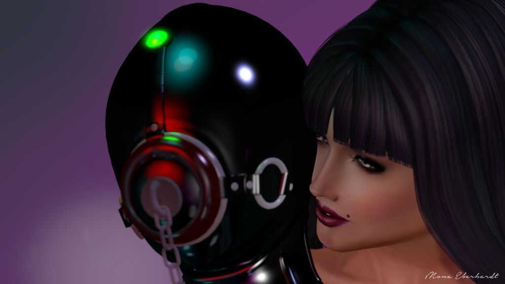 Mistress Ani (on the right), whispering to Her rubber doll.